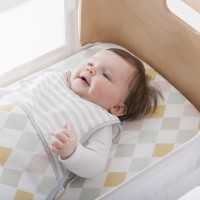 olli ella harlequin sheet for bednest smiling baby