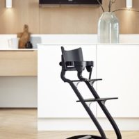 leander high chair black with saftey bar in kitchen lifestyle