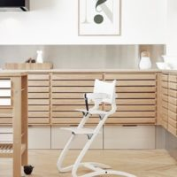 leander high chair white in kitchen with safety bar