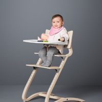 leander high chair with baby